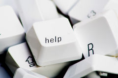 Help button. Help key on top of various other keys Royalty Free Stock Photography