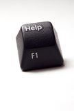 Help button from computer keyboard. A black computer keyboard white isolated help button stock photos