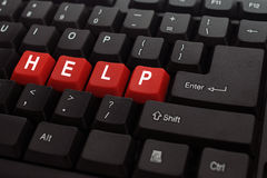 Help button word on black keyboard Royalty Free Stock Images