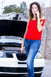 Help calling. Woman calling insurance for help about car engine failure Royalty Free Stock Photo