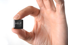 Help computer key in hand Stock Image