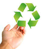 Help concept. Hand holding a recycle sign Royalty Free Stock Photo