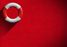 Help Concept - Red and White Lifebuoy. Red and white lifebuoy hanging to a red velvet wall - Concept of help Royalty Free Stock Photo