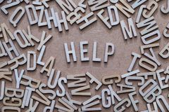 Help concept, word spelled out in wooden letters Stock Image