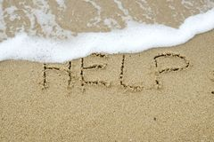 HELP written on sand royalty free stock photography