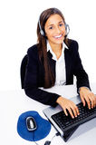 Help desk call center. Friendly call center secretary consultant woman with headset telephone and pretty smile Royalty Free Stock Images