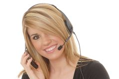 Help Desk Girl 1. Lovely blond woman working at help desk with headset and cell phone Stock Photography