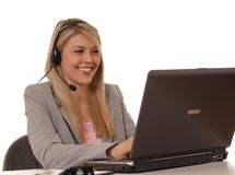 Help Desk Girl Smiling. Business lady at computer with headset Stock Photography