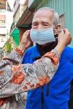 Help elderly people to wear mask Royalty Free Stock Photo