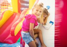 Help every time. Two little girl playing together. Space for copy. Close up stock photos