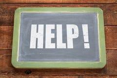 Help exclamation on blackboard Stock Photography