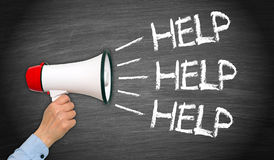 HELP - female hand with megaphone and text. On chalkboard background royalty free stock photo