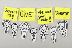 Help Give Charity Donation Concept. Group of people with support, give, help and donate words Royalty Free Stock Images