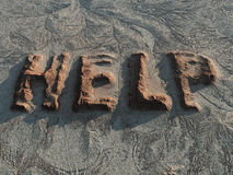 Help from the global erosion. Help word on an eroded surface Royalty Free Stock Photos