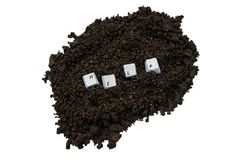 Help. H e l p keyboard buttons in soil Stock Photography