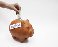 Help Haiti. A piggy bank - Donate to help Haiti Royalty Free Stock Images
