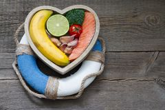 Help for heart abstract health diet food concept with lifebuoy. Closeup Royalty Free Stock Photography