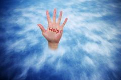 Help!. A helping hand seeking rescue royalty free stock image