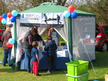 Help for Heroes or vets stall. A Help for Heroes stall at a local village event. Items for sale to raise money for this charity. Help for Heroes (H4H) is a Royalty Free Stock Photography