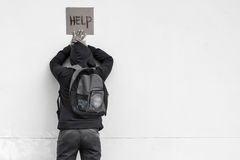 Help. Homeless person with help sign,Poverty issue Royalty Free Stock Photos