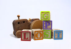 Help, I am lost!. Wooden toy blocks spelling GPS and Lost with a wooden handmade toy car or truck Stock Image