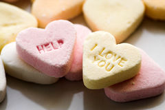 Help i love you. Candy message royalty free stock photo