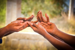 Help. Indian Children's Hands for help Stock Photos
