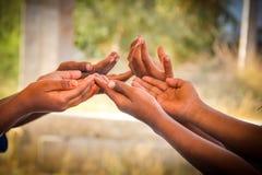 Help. Indian Children's Hands for help stock photos