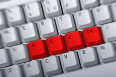 HELP Keyboard. Keyboard with red keys HELP nexto t each other. Zoom blur to intensify the concept Stock Photos