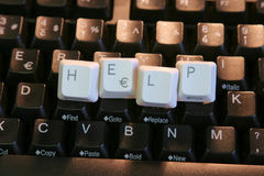 Help Keys. Black computer keyboard with white keys spelling HELP in the middle Royalty Free Stock Images