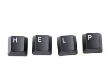 Help keys. Four black computer keyboard keys arranged to spell HELP word isolated on white Royalty Free Stock Photography