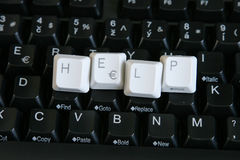 Help Keys 2. Black computer keyboard with HELP spelled in white keys on center of keyboard Stock Photography