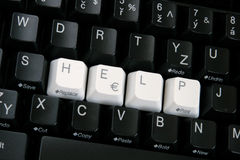 Help Keys 3. Black computer keyboard with HELP spelled out in white keys in the center of the keybaord.  Taken at an angle Royalty Free Stock Photos