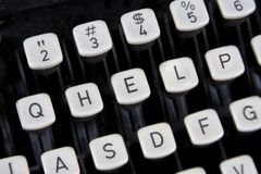HELP keys on old keyboard. HELP spelled out on old typewriter keyboard royalty free stock photos