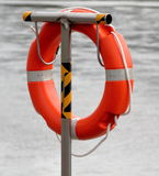 For help. Lifebuoy on the Vistula river in Torun, Poland royalty free stock images