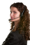 Help Line. Corporate woman talking over her headset, isolated in a white background Royalty Free Stock Photos