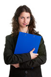 Help Line. Corporate woman talking over her headset, isolated in a white background, holding a blue pad Stock Images