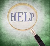Help magnify. By 3d rendered magnifying glass on green grunge background Royalty Free Stock Image
