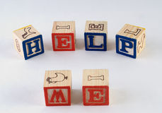 Help Me. The words help me, spelled using wooden baby blocks Royalty Free Stock Photos