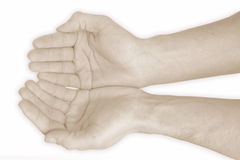 Help me hands. Studio photo from two hands in red Stock Photography