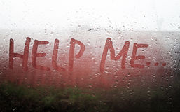 The Help Me inscription. On the sweaty glass Royalty Free Stock Images