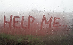 The Help Me inscription. On the sweaty glass Stock Photos