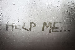 The Help Me inscription. On the sweaty glass Stock Photography
