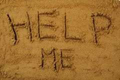 Help me in the sand Royalty Free Stock Images