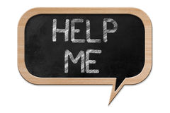 Help me on a Speech bubble shaped Blackboard Royalty Free Stock Photography
