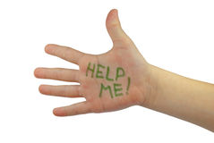 Help me! written on the child's hand Royalty Free Stock Images