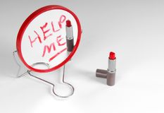 Help Me Written on Mirror. Help Me Written on Hand Mirror with Red Lipstick Stock Photos