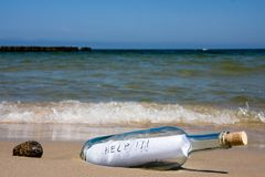 Help message in bottle. Close-up of help message in bottle on a sea shore Stock Photos
