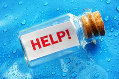 Help message in a bottle. Concept for sos, assistance, service and support royalty free stock image