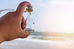 HELP message in glass bottle. On hand Royalty Free Stock Photo